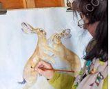 Kate Wyatt painting in her studio
