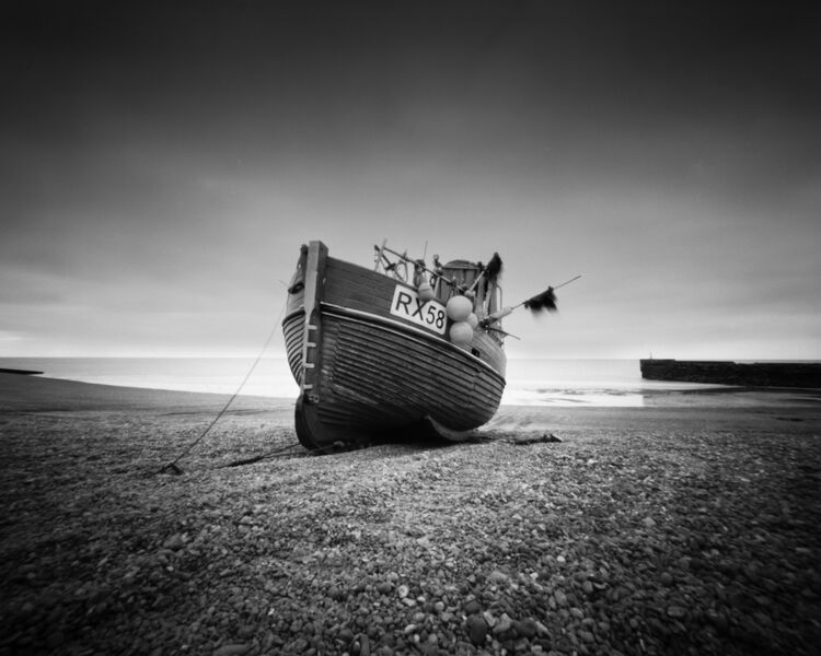Fishing boat RX58 on Hastings beach, East Sussex.